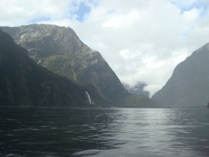 Travel for fun, Milford Sound, visit New Zealand South Island: A view from a kayak on a cloudy day of Milford Sound