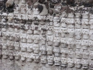 Travelling for Fun, visit Mexico, What to do in Mexico City, Attractions, Zocalo, Templo Mayor: Templo Mayor was the heart of the Aztec empire and was discovered in 1978. These skulls cut out of rock decorate a wall remind us that human sacrifice was very important to keep the Gods happy. Some of the skulls looks happy at least!