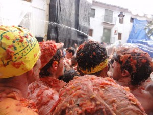 Travelling for fun, Tomatina, Bunol, Spain:It gets a little messy at Tomatina! Some shampoo and conditioner will be needed after an hour of tomato throwing at Tomatina