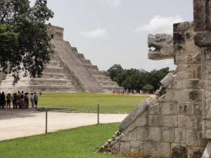 Travelling for fun, visit Mexico, Sightseeing in Chichen Itza: A jaguar sticks his head out of the Jaguar Temple as El Castillo dominates the background. Visiting Chichen Itza is top of man peoples 'things to do' lists.
