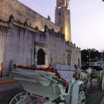 Travelling for fun, visit Mexico, visit Merida : The cathedral of Merida on Plaza Grande lies in the background of a tourists horse drawn carriage. Merida is the capital of Yucatan and has lots of historic buildings and parks.