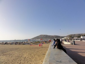 Visit Morocco, Agadir, Travelling for Fun: Locals enjoy the sun and sand on the edge of the beach in Agadir, Morocco