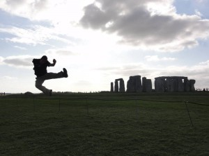 What is Stonehenge, Salisbury, visiting England, Travelling for fun: Doing my bit for entertaining my fellow tourists as I show off my jumping skills next to the iconic standing stones of Stonehenge