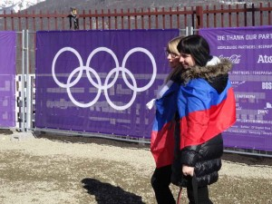 Sochi, Winter Olympics 2014, Russia, Rosa Khutor, Travelling for Fun: Russian fans pose with the Russian flag at the men's freestyle slopestyle event in Rosa Khutor.