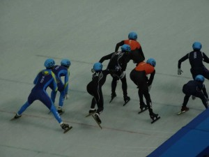 Sochi, Winter Olympics 2014, Russia, Olympic Park, Travelling for Fun: The organised chaos of a speedskating team relay event around a 111mtr track. When the athletes swap they push each other like in the photo. From left to right its Kazakstan, USA, Netherland and Korea. The favourites USA and Korea both crashed out with Korea getting penalised.