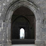 Celtic Crosses, visiting the Rock of Cashel, Tipperary, what to do in Ireland, Travelling for fun: Celtic crosses peak through doors of the cathedral