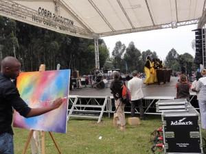 Kwita Izina, Volcanoes National Park, Gorilla trekking, Rwanda: A local paints the scene live